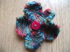 Knitted flower brooch