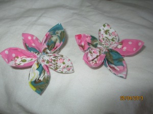 Gather each petal using running stitch and sew them together to make a flower.